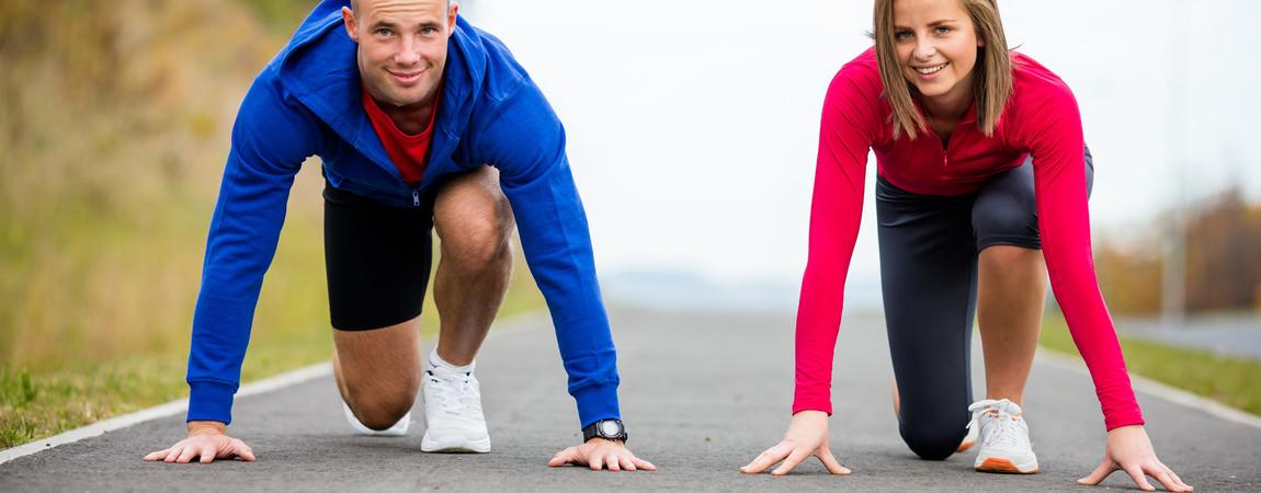 Urban leisure – woman and man ready to run